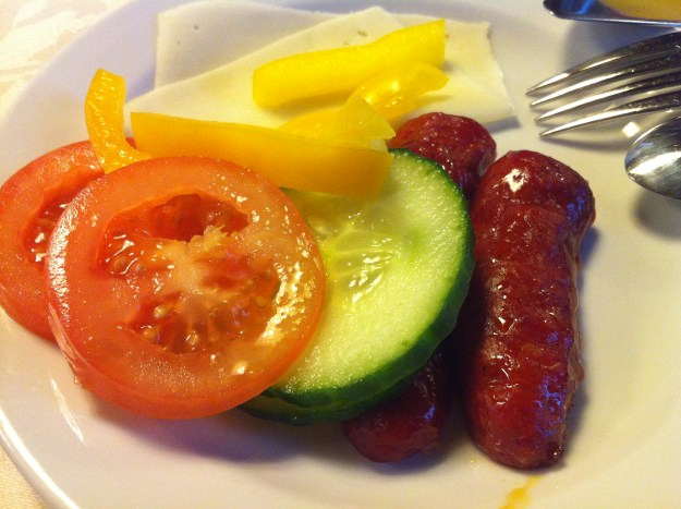 A Czech Continental Breakfast of kiełbasa sausage, cucumber, sliced, sweet peppers, and slices of cheese!