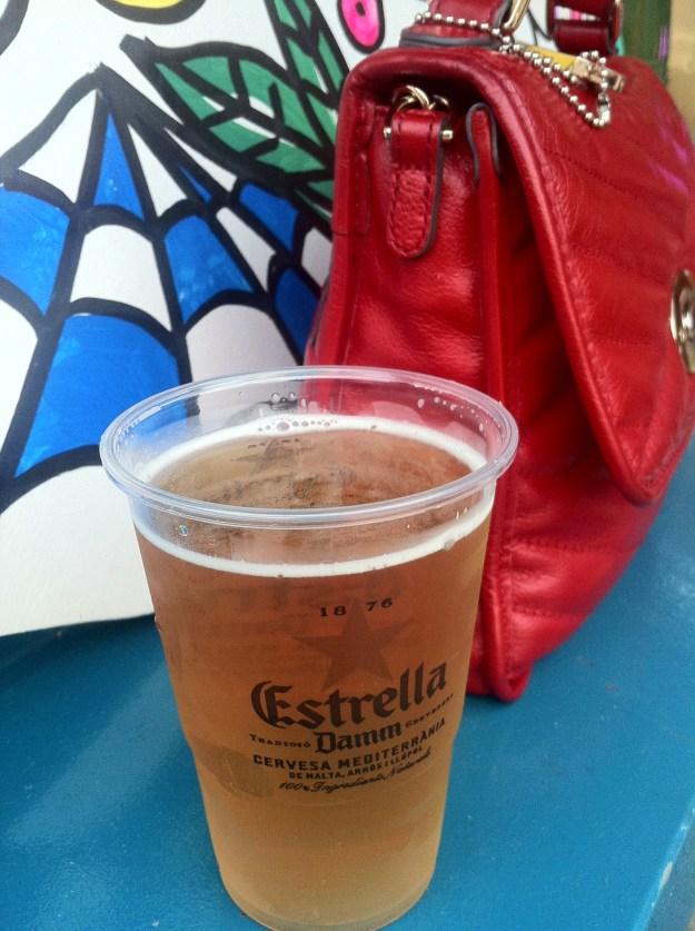 Spanish beer & my little red handbag at a street food market in Lloret de Mar - Spain.