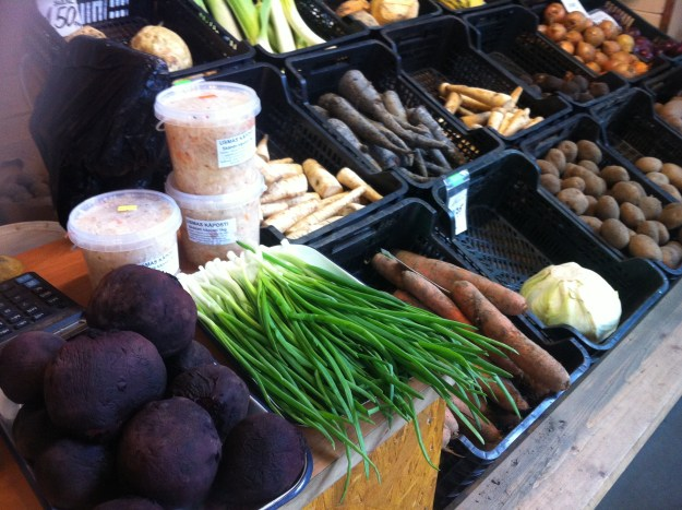 Carrots, turnips, swede, spring onions, shallots and other strange vegetables found at the farmers' food market in Riga, Latvia.
