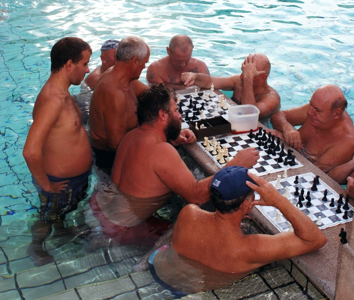 Chess players in the Széchenyi Thermal Bath and Swimming Pool NOT at the Aria Hotel of course! - Budapest.