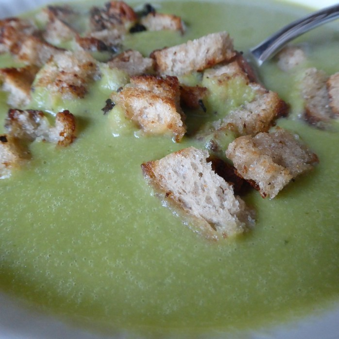 A bowl of cream of apple cider soup with fresh chopped chives and butter croutons. Yum!