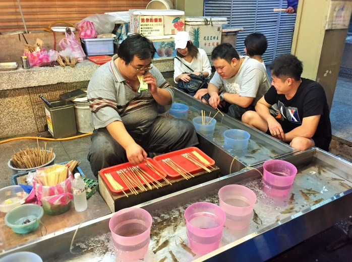 Fishing for live shrimps at the night market, in Taiwan!