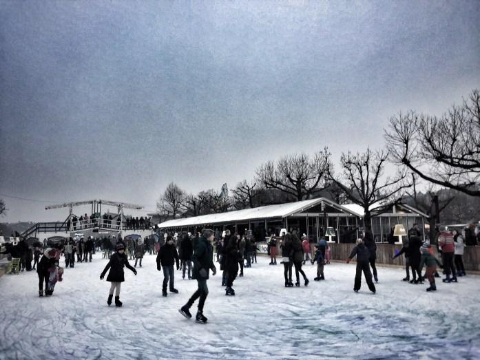 ice-skating; people ice-skating; Amsterdam skating rink; skating rink; ice; skate; skating; wintersport; sport; local sport; Amsterdam; Holland; Netherlands; Europe; travel; family travel;
