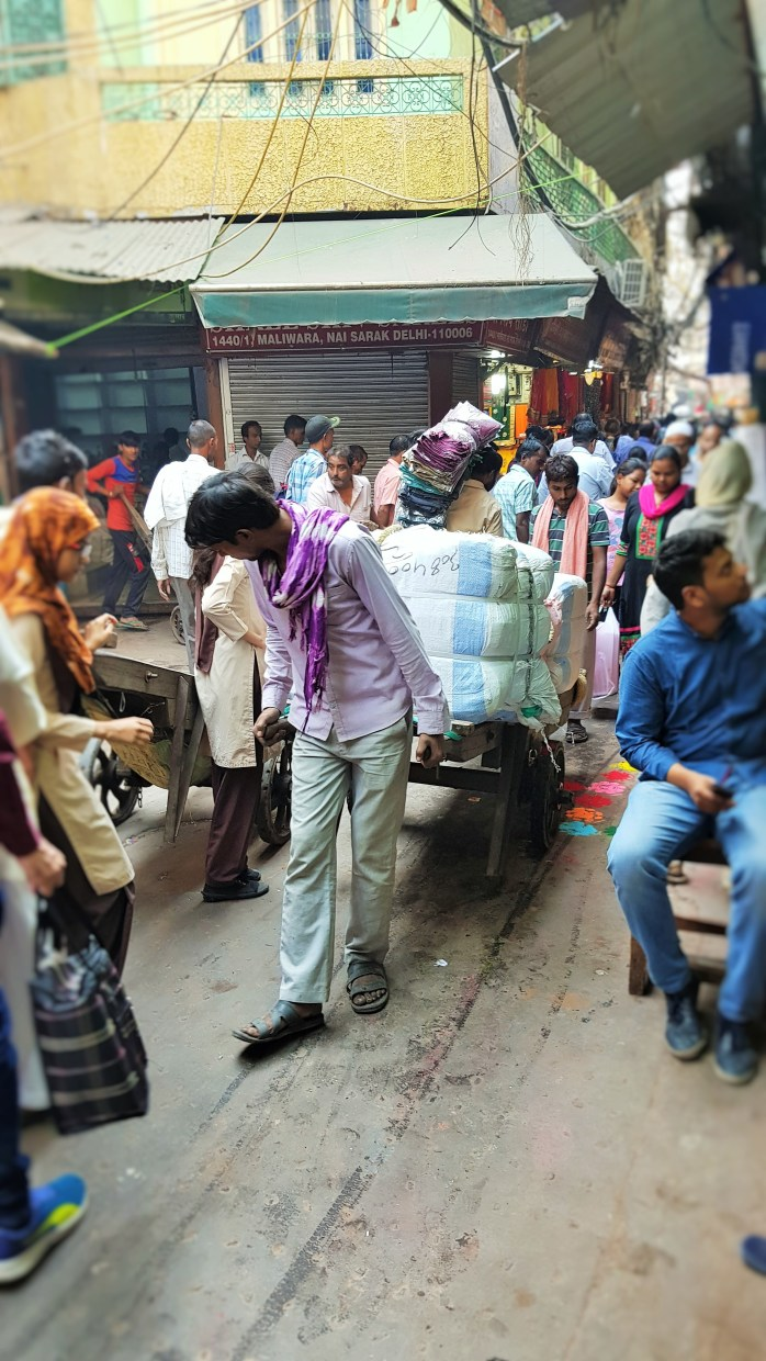A man at work in India; working; man; Indian man; Indian; Delhi