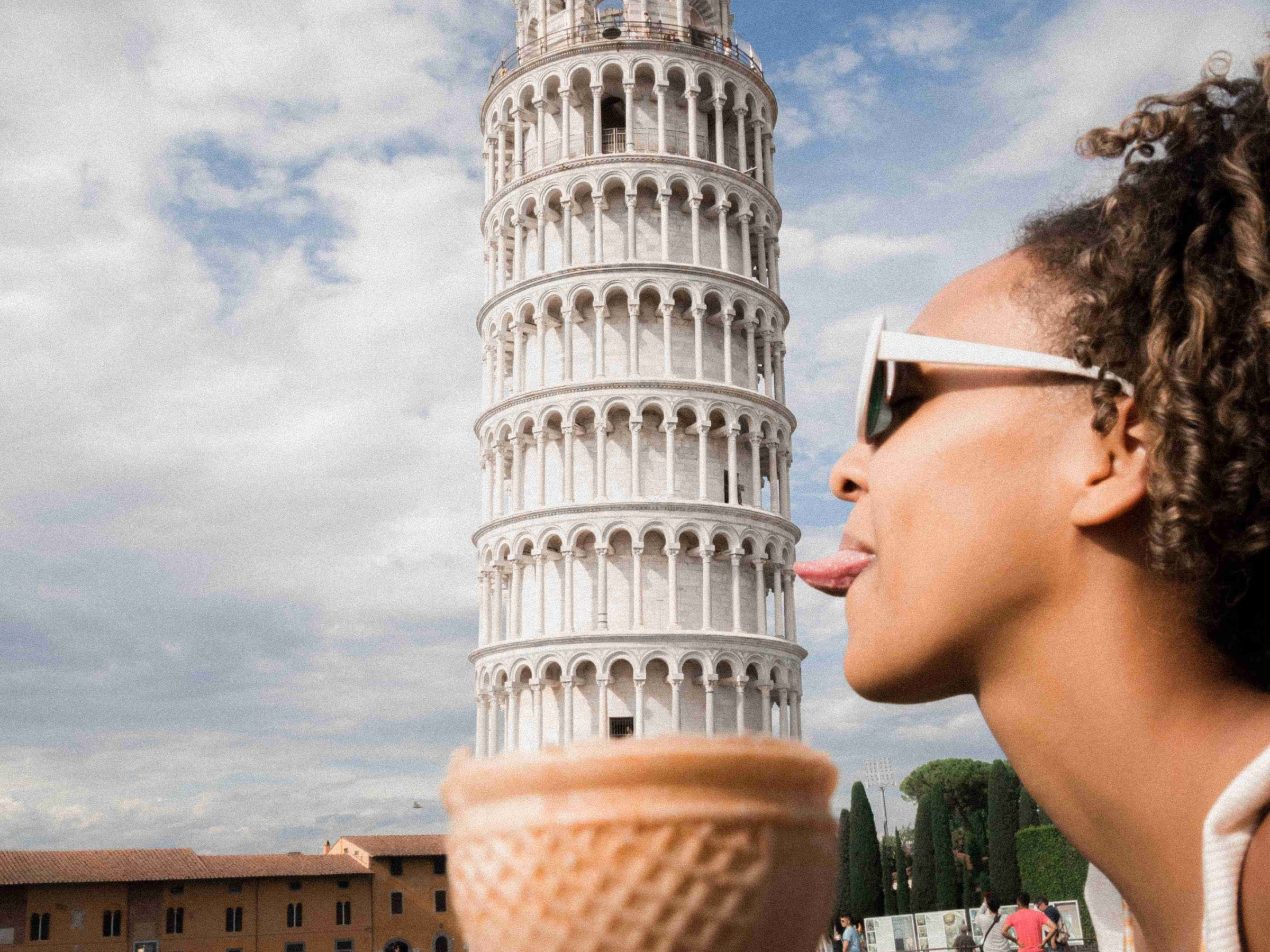 Pisa; leaning tower of Pisa; Italy; ice-cream, girl; girl licking ice-cream; ice-cream cone; lick; funny; humour; humor; tower; girl in Pisa; girl; woman; travel; Europe;