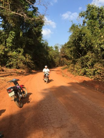 Red dirt road at the entrance of the national park, it was about 1:50 p.m.
