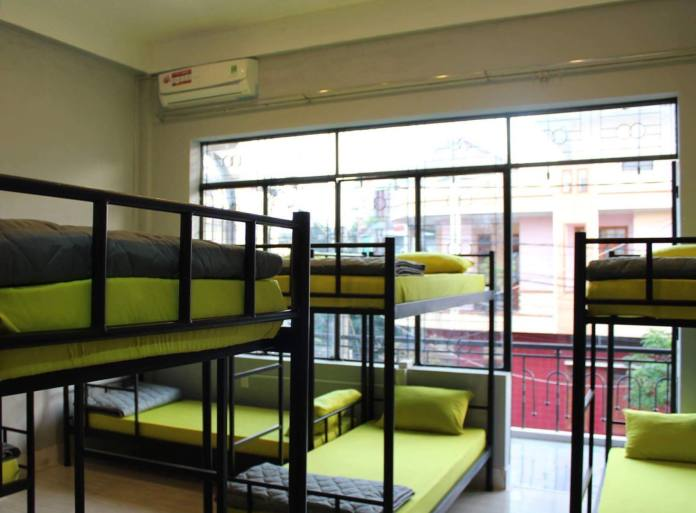 largest bedroom with a cute balcony at O.M.E hostel - Quy Nhon, Vietnam
