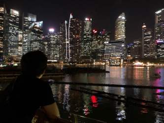 me looking at financial districts from marina bay sands singapore