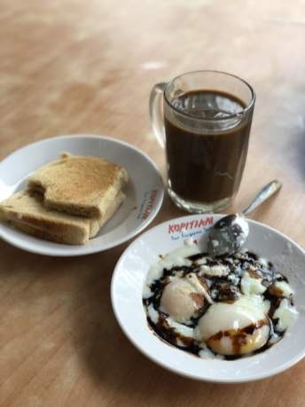 Kaya Toast with Half-cooked eggs, the iconic traditional Singapore breakfast