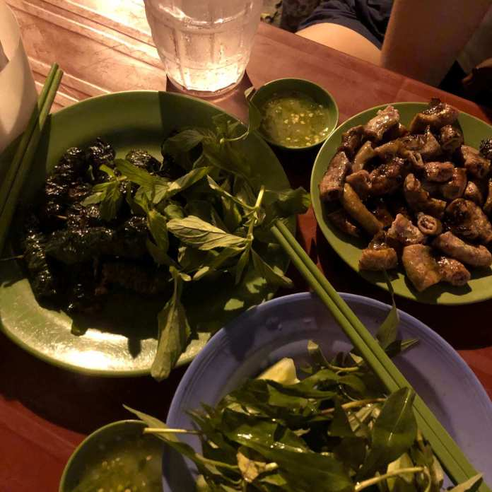 Dishes of grilled meats for a warm night in Nha Trang food tour