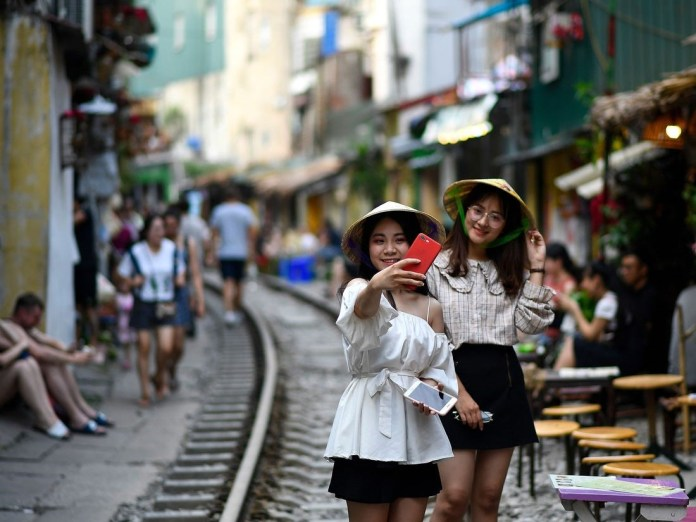 Visitors come to take pics and selfie at Hanoi Train Street