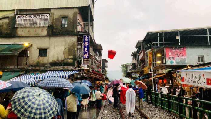 Visitors release sky lanterns at Shifen Old Street, Taipei, Taiwan