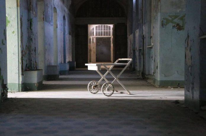 abandoned hallway of Beelitz Heilstätten Sanatorium