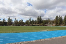 COCC track and field are empty on Wednesday due to mandatory campus closure, April 15. Photo by Kayla Scott.