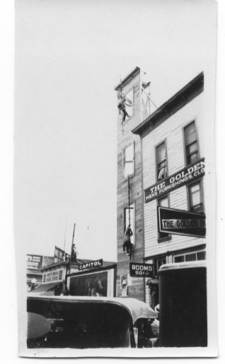 Bend Fire Department; fire practicing with wood ladder - Downtown Bend Photo Credit: Deschutes County Historical Society