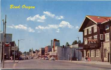 Downtown Bend, looking south toward corner of Newport/Greenwood and Wall Street Photo Credit: Deschutes County Historical Society