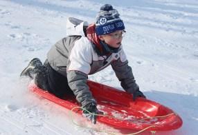 sledding boy