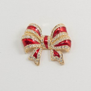red and gold christmas bow pin with rhinestones