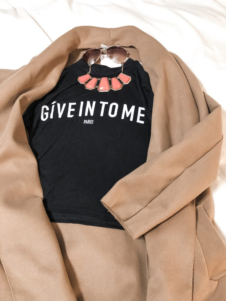 https://femmeluxefinery.co.uk/products/black-give-it-to-me-print-tee-giovanna