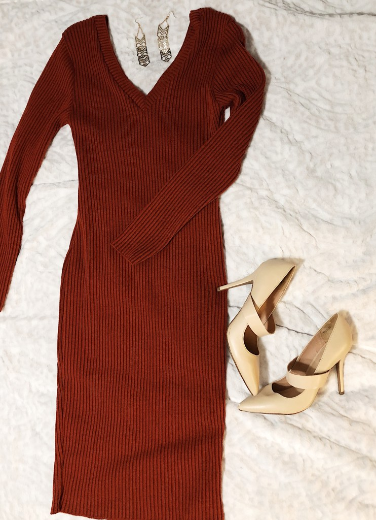 https://femmeluxefinery.co.uk/products/rust-ribbed-v-neck-midi-jumper-dress-ivy