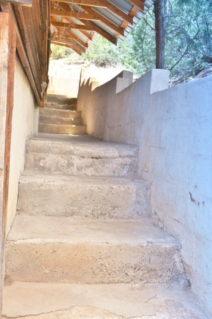 Stairs from the outdoor shower to the grill area.