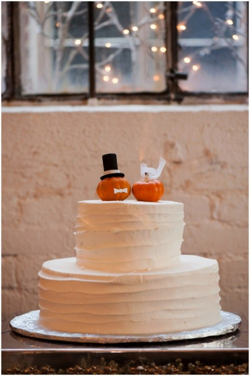 Pumpkin Themed Wedding With White Wedding Cake and Pumpkin Groom and Bride
