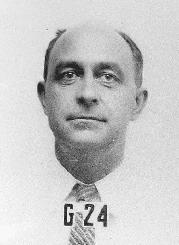 Enrico Fermi's ID badge photo from Los Alamos.