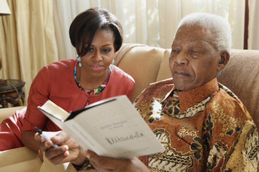 U.S. First Lady Michelle Obama visits former South Africa president Nelson Mandela in June of 2011. (Google Images)