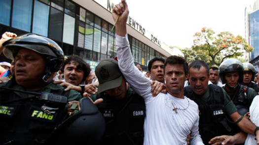 Venezuelan opposition leader Leopoldo Lopez has turned himself into police to face charges of murder, terrorism and arson.  (Photo Credit: Google Images)