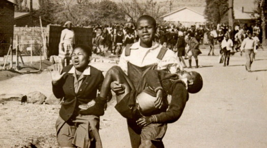 Iconic photo of Hector Pieterson, 13, being carried by Mbuyisa Makhubo after being shot by South African police. His sister, Antoinette Sithole, runs beside them. (Photo taken by Sam Nzima)