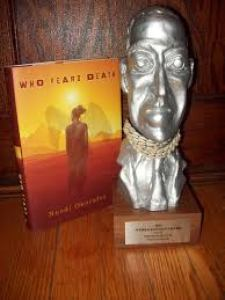 """Nnedi Okorafor's World Fantasy Award next to her book """"Who Fears Death."""" (Photo Credit: Google Images.)"""