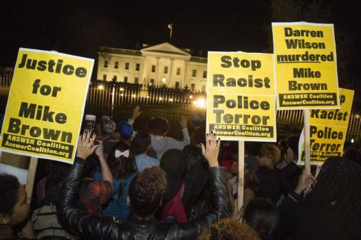 Protesters gather in front of the White House to protest the Ferguson grand jury's decision not to indict Officer Darren Wilson in the killing of unarmed teen Michael Brown, 18.