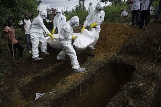 Ebola victims are buried in mass graves in Sierra Leone. (Photo: National Geographic)