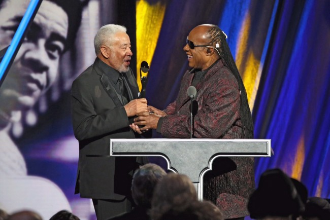 Stevie Wonder (R) inducts Bill Withers during the 30th Annual Rock and Roll Hall Of Fame Induction Ceremony at Public Hall on April 18, 2015 in Cleveland, Ohio.  (Photo by Kevin Kane/WireImage for Rock and Roll Hall of Fame)