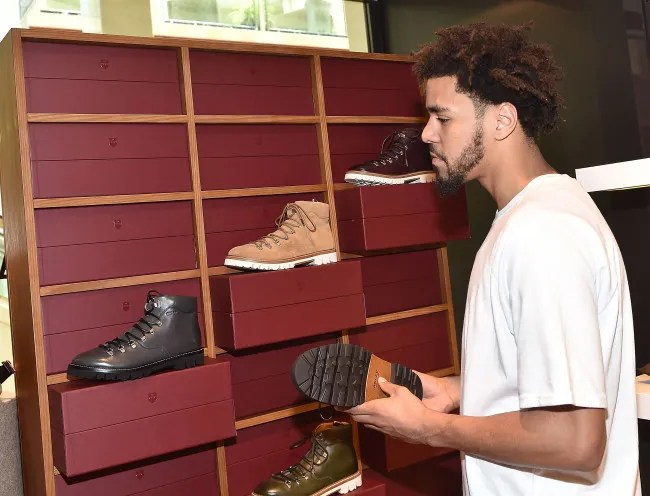 ATLANTA, GA - AUGUST 15: Rapper J. Cole attends J. Cole For Bally Cocktail at Bally Phipps Plaza on August 15, 2015 in Atlanta, Georgia. (Photo by Paras Griffin/Getty Images for Bally)