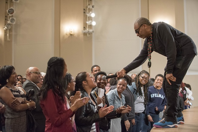 Lee leads a call-and-response chant following '2 Fists Up' screening at Spelman College (Photo Credit: Spelman College)