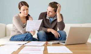 Man-and-woman-looking-at-bills-563138