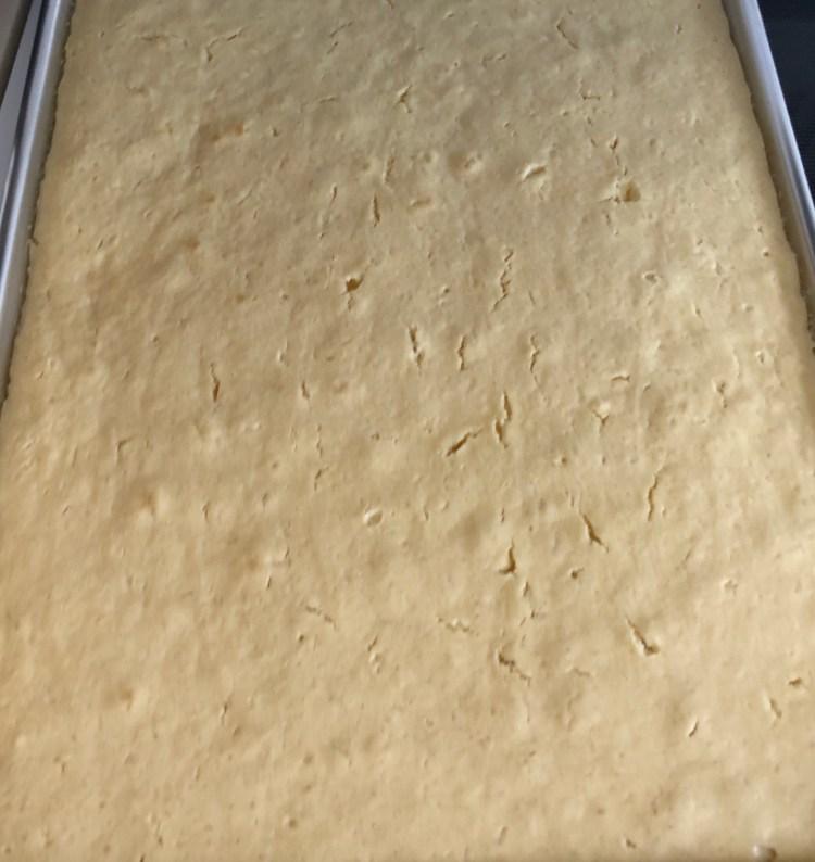 Lemon Sheet Cake freshly baked in the sheet pan
