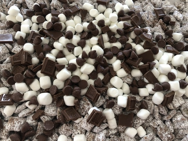 Milk Chocolate chips added to the S'mores Muddy Buddies snack mix