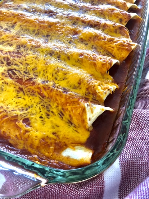 baked easy chicken enchiladas with red enchilada sauce and cheese
