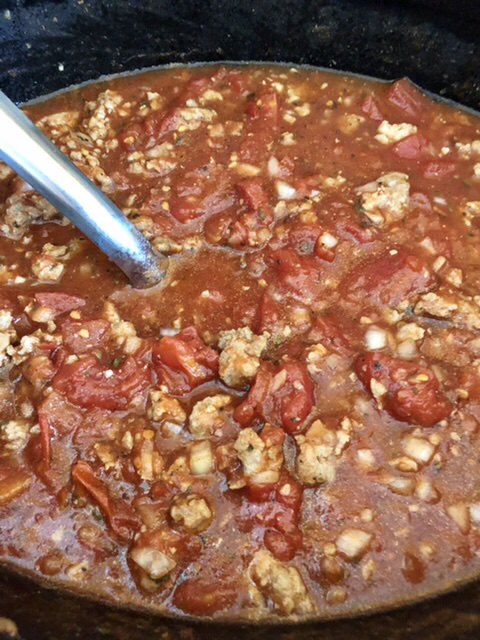 diced tomatoes, Italian ground sausage and seasoning in the slow cooker for homemade spaghetti sauce
