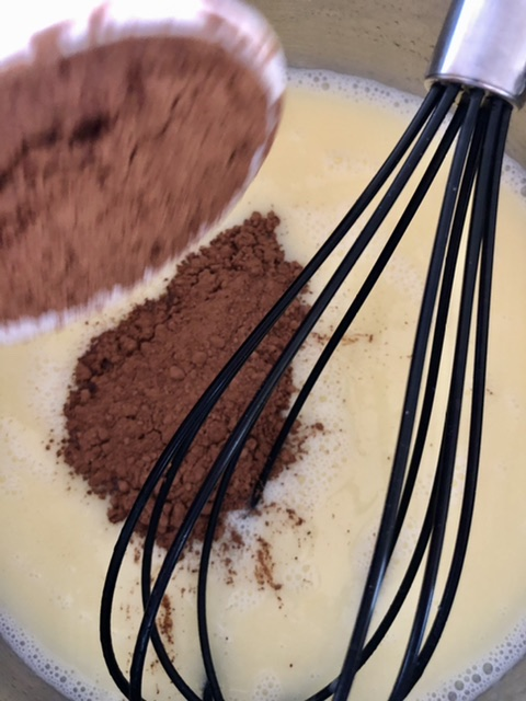 cocoa and vanilla added to the warm butter and milk for frosting for the best Easy Texas Sheet Cake