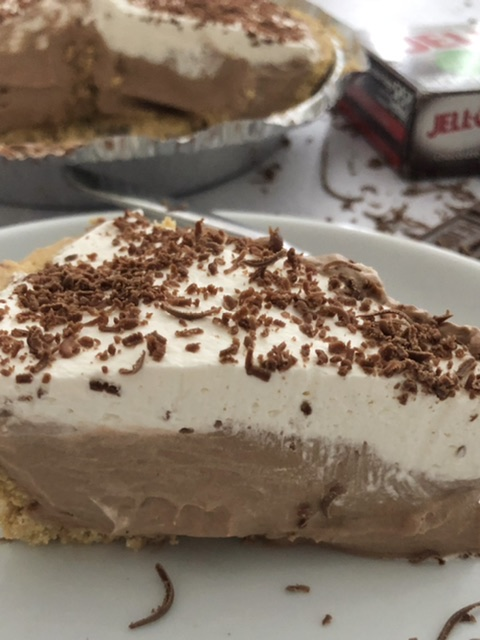 slice of easy chocolate cream pie with whipped cream and chocolate shavings on top