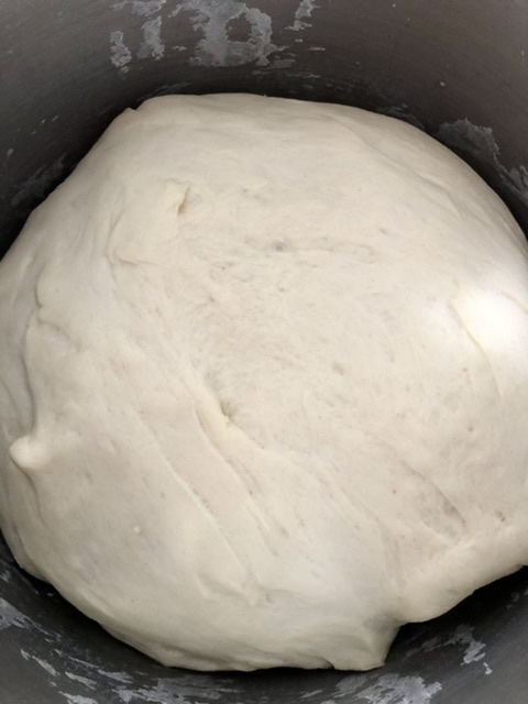 pretzel dough that has doubled in size and raised for one hour and is ready to make soft pretzel bites