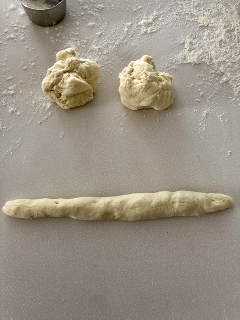 pretzel dough rolled out into a long piece of dough