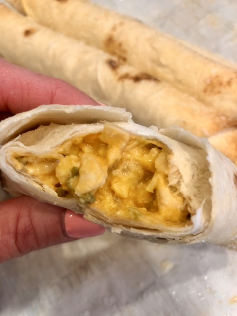 buffalo ranch taquito torn open to see the filling