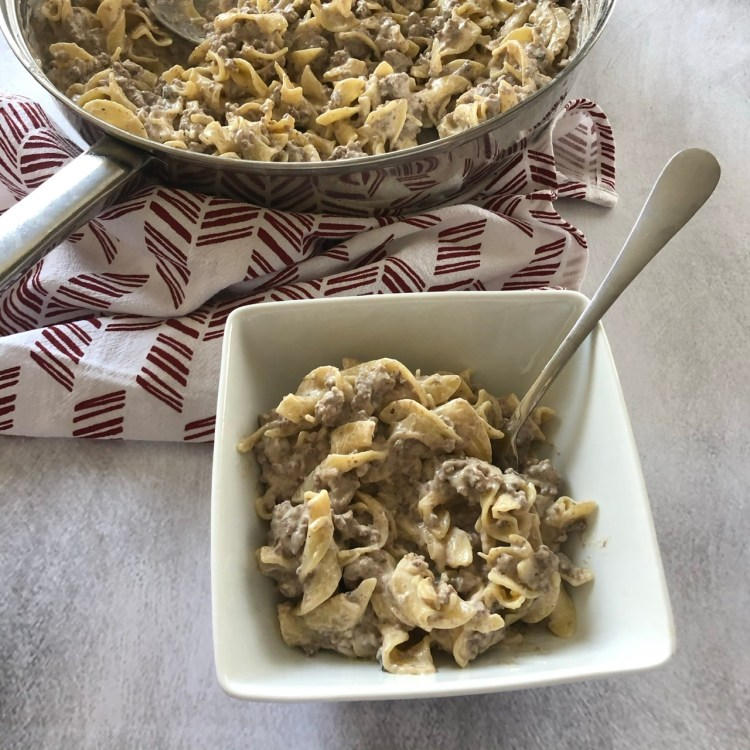 stroganoff made with ground beef in a serving dish