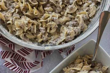 Easy Ground Beef Stroganoff in a skillet with a dish next to it