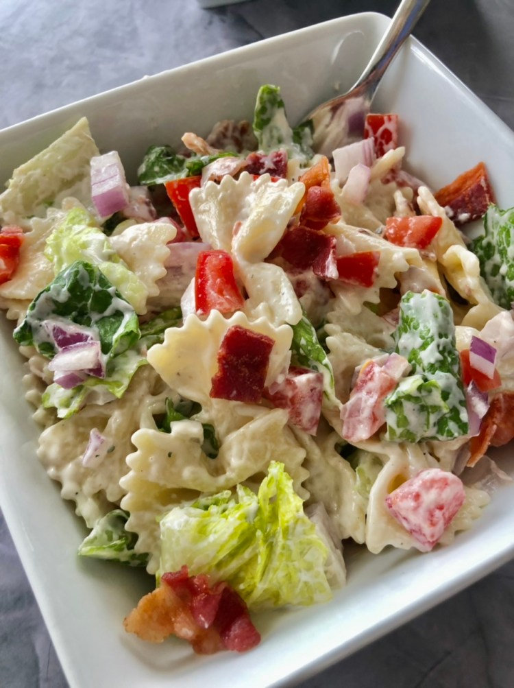 up close shot of a serving of easy BLT Pasta salad with ranch dressing