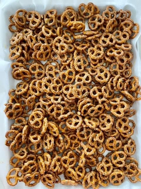 mini pretzels on a sheet pan lined with parchment paper